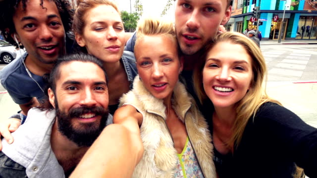 SLOW MOTION - Young Friends Fun Selfie on Santa Monica Street, Los Angeles. video