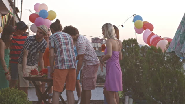 Young friends having fun on urban rooftop party