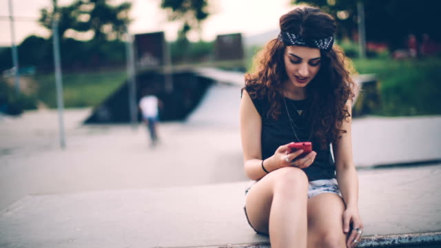 Young funky woman enjoying at skate park in sunset video