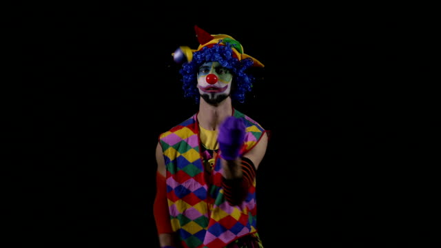 Young funny hilarious clown juggling video