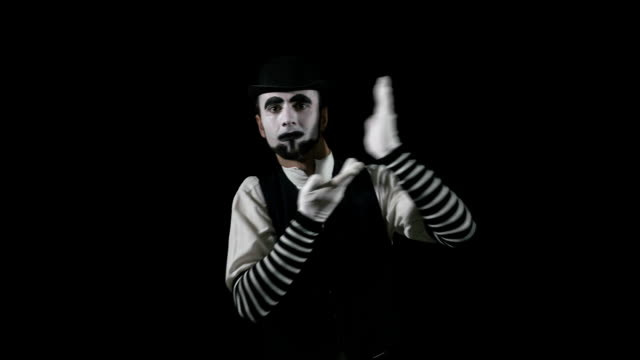 Young funny mime performing a pantomime act video
