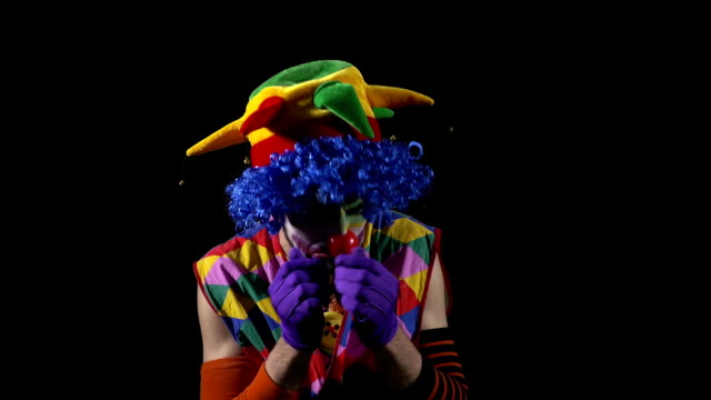 Young funny sad clown crying and blowing nose in hat video
