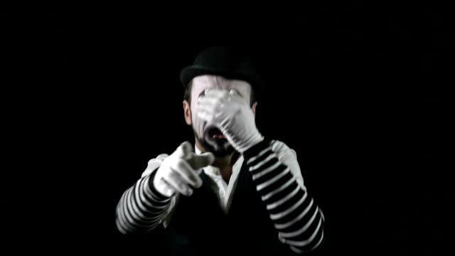 Young funny sad mime crying and blowing nose in hat video