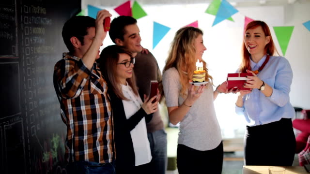 young girl celebrating her 27st birthday with friends - office party stock videos and b-roll footage