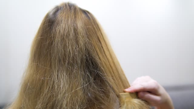 young girl combs her hair. close-up of slow motion young girl combs her hair. close-up of slow motion highlights hair stock videos & royalty-free footage