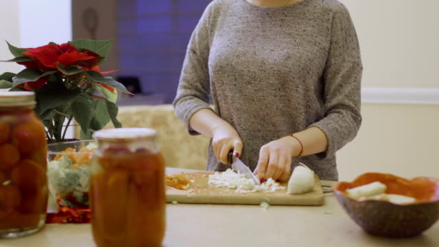 Young girl cuts cabbage for salad video