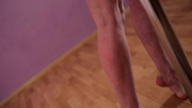 Young girl dancing with a pole in the dance studio video