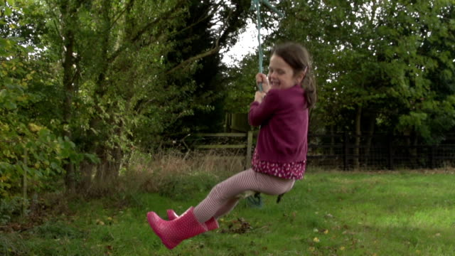 Young Girl Enjoying A Rope Swing video