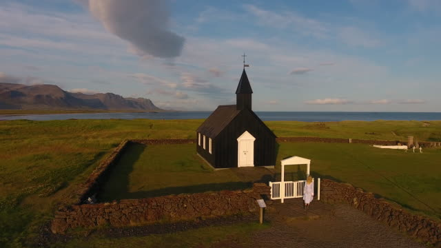 A young girl explores a black church in Iceland. Fairytale Fashion Story