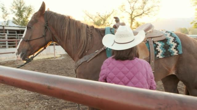 young girl horseback riding - sella video stock e b–roll
