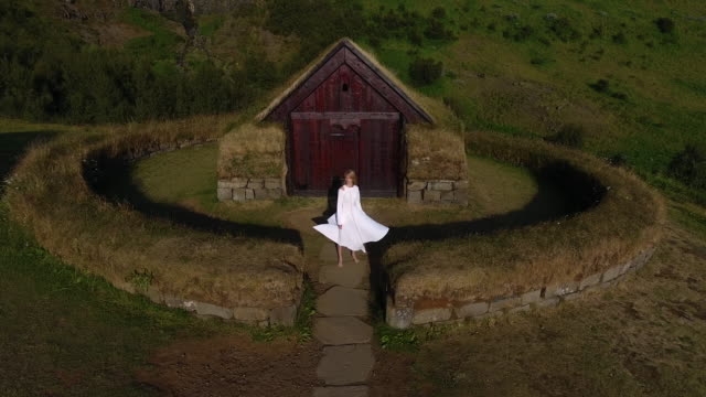 Young girl in an ancient settlement of the peoples of Iceland. Fairytale Fashion Story - video