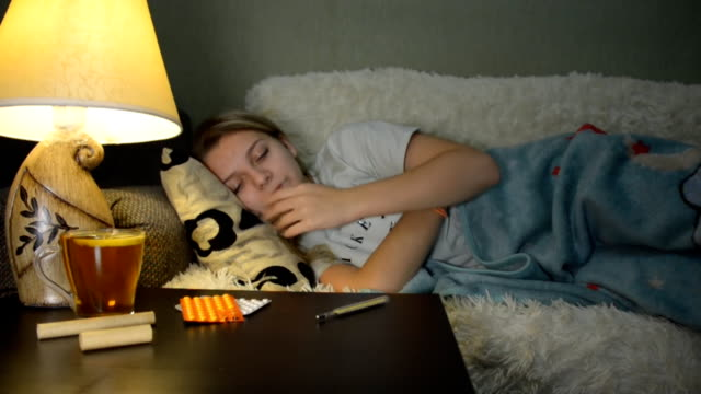 Young girl in bed sick, need a doctor video