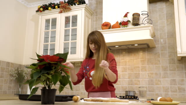 Young girl is cooking the Christmas cookies video
