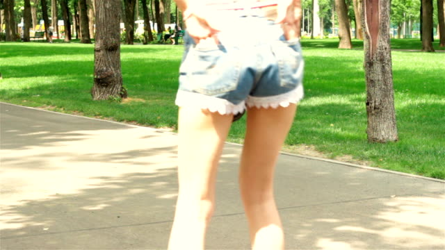 young girl keeps hands in her pockets and went rollerblading young girl keeps her hands in her pockets and went rollerblading in the Park charming stock videos & royalty-free footage