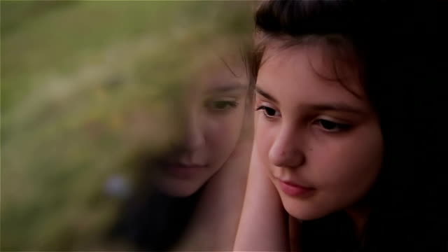 young girl looking out of car window - bus stock videos and b-roll footage