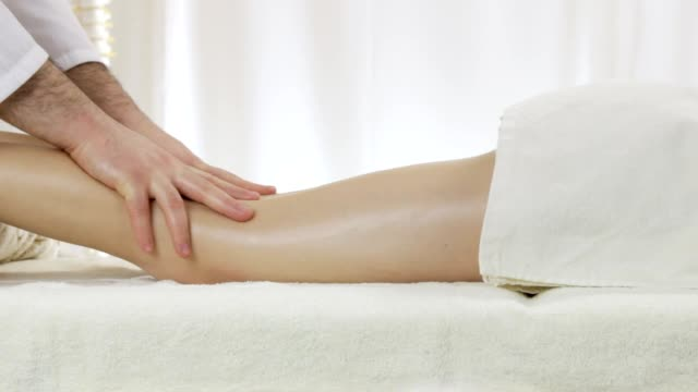 A young girl masseuse at a massage parlor, a relaxing foot massage video