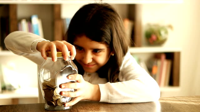 Young Girl Nerd Saves Money in His jar Bank