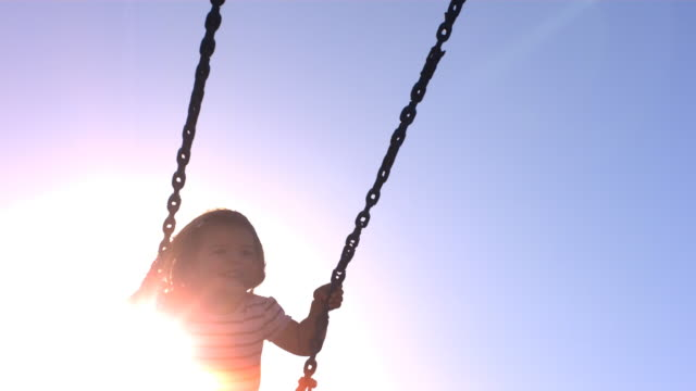 Young girl on swing, slow motion video