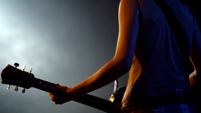 Young girl playing guitar on a stage video
