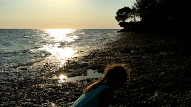 Young Girl Playing on Coastline During Sunset Young Girl Playing on Coastline During Sunset. tanzania stock videos & royalty-free footage