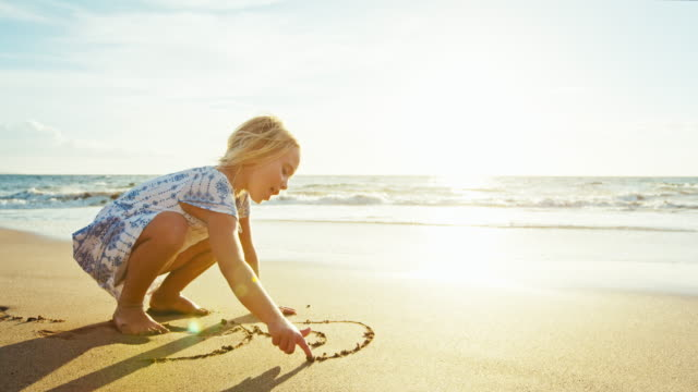 Young Girl Playing on the Beach video