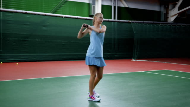 Young girl playing tennis. Healthy lifestyle and everyday practice video