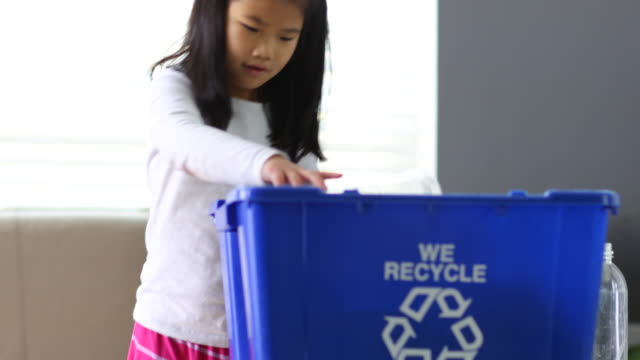 young girl putting bottles in recycle bin - recycling stock videos & royalty-free footage