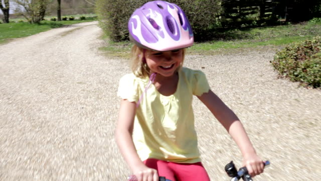 Young Girl Riding Bike Along Country Track video