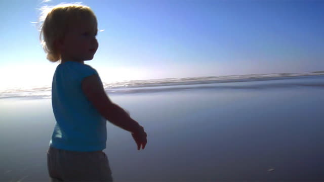 Young Girl Runs On Beach video