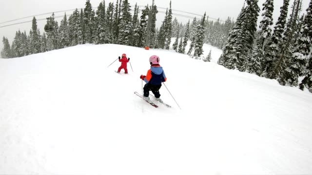 young girl skiing down the slope - sci video stock e b–roll