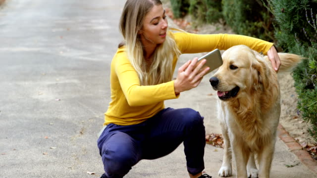 Young girl taking selfie with her dog 4k Smiling young girl taking selfie with her dog 4k telephone receiver stock videos & royalty-free footage