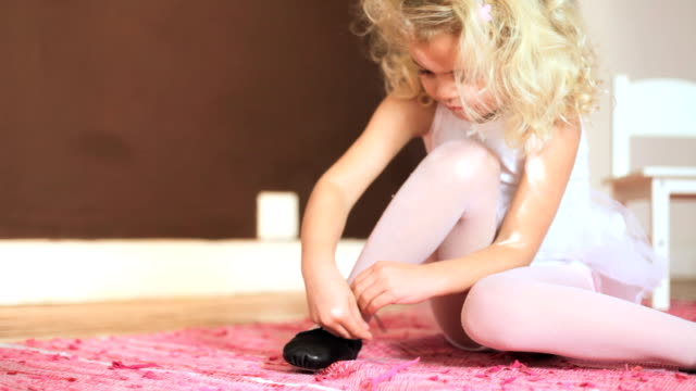 Young girl tying her shoelace video
