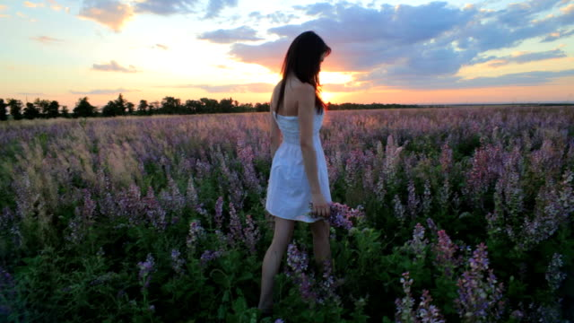 Young Girl Walking in Field of Lavender video