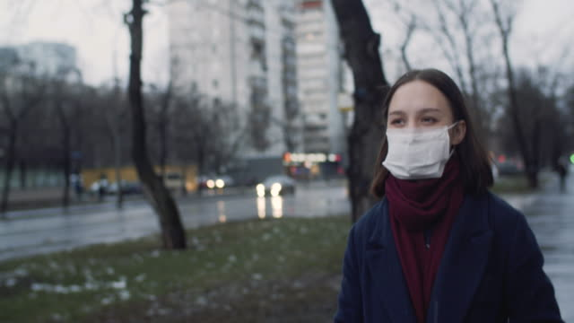 Video Young girl wearing a protective face mask