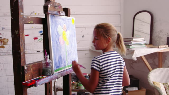 Young Girl Working On Painting In Studio Shot On R3D Camera video