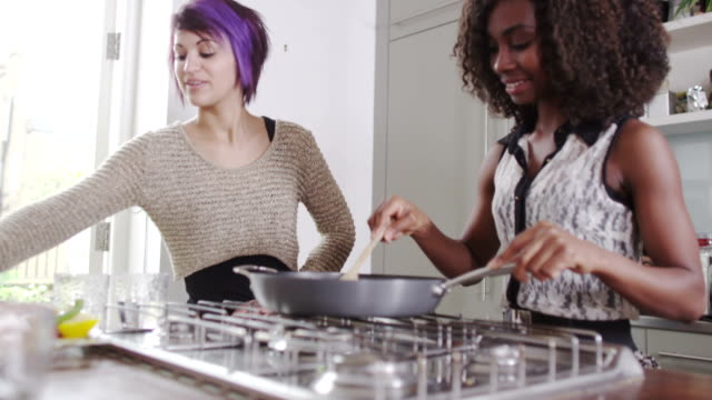 Young girlfriends cooking together video