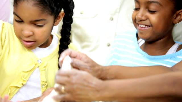 Young Girls Kitchen African American Grandparents video