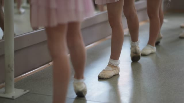 Young girls on ballet class Group of young girls practicing ballet in ballet studio dance studio stock videos & royalty-free footage