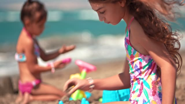 Young Girls On Summer Vacations Playing On Beach Sand Stock