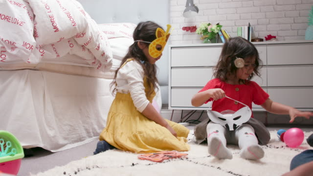 2 young girls playing together at home in their bedroom 2 young girls playing with animal face masks together at home in their bedroom mask disguise stock videos & royalty-free footage