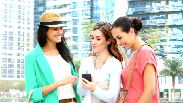 Young girls using mobile phone in Dubai video