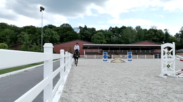 A young guy rides on a horse video