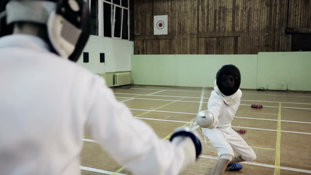 Young guys fencers practicing fencing duel video
