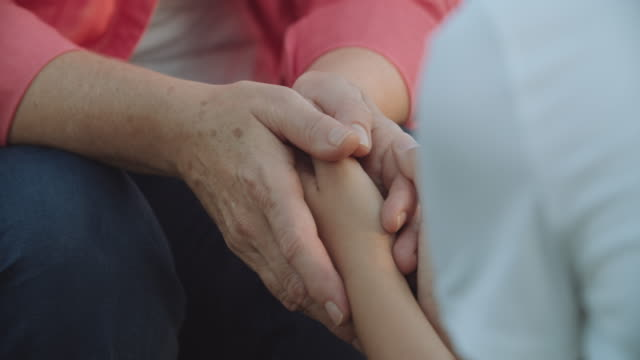 Young hands giving support old hands