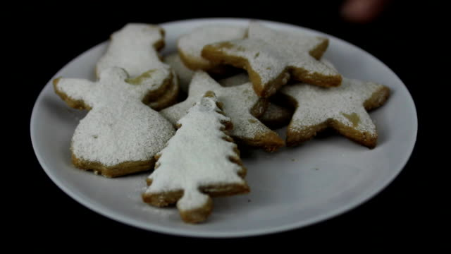 Young hands taking Christmas cookies video