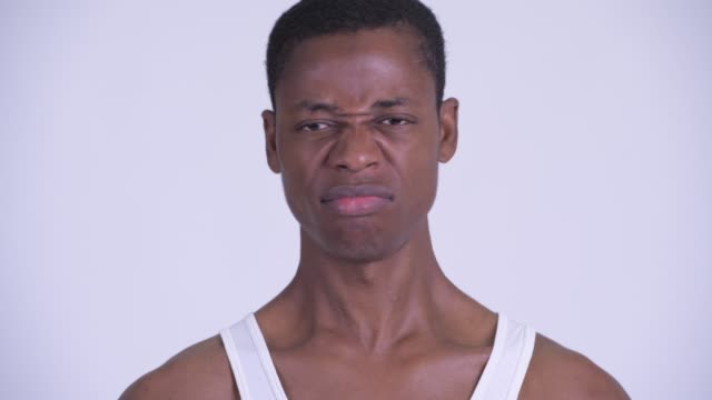 Young handsome African man Studio shot of young handsome African man against white background tank top stock videos & royalty-free footage