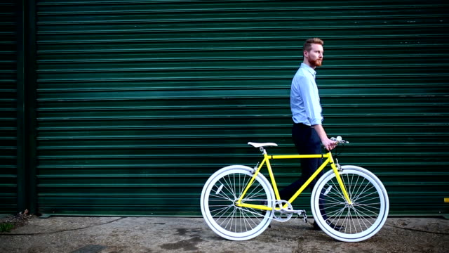 young handsome male walking with yellow retro bike - preppy fashion stock videos and b-roll footage