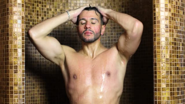 Young Handsome Man Taking A Shower In A Spa Video