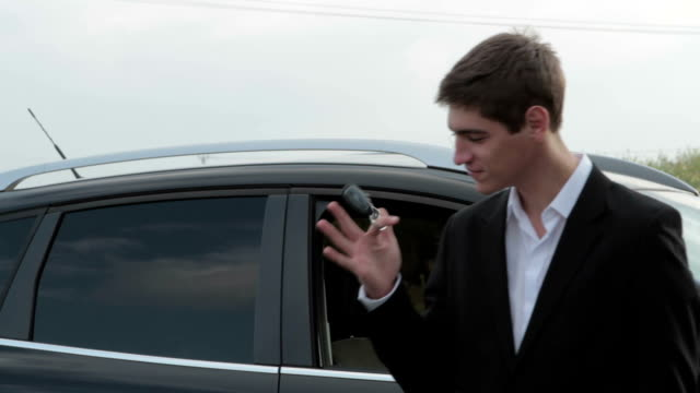 Young handsome man with car key in hand video