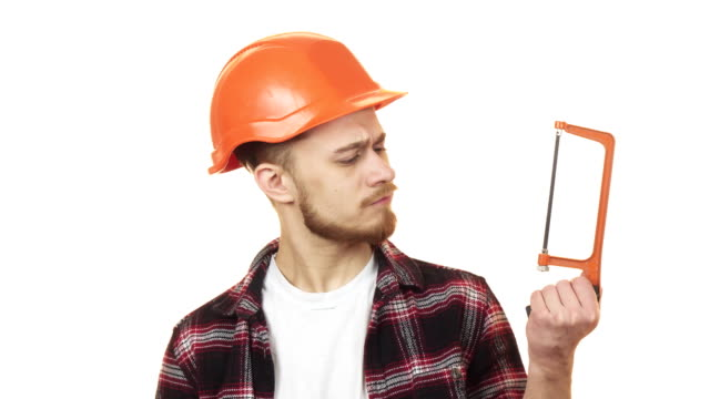 young handyman choosing between two saws to use - craftsman architecture stock videos & royalty-free footage